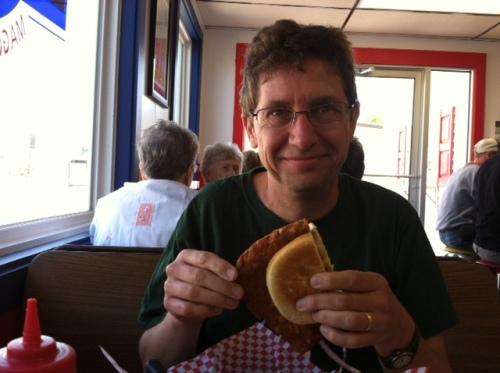 Eating half - yes, just half - of a Goldie's Pork Tenderloin sandwich