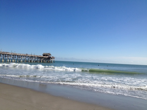 Surfers at cocoa beach pier